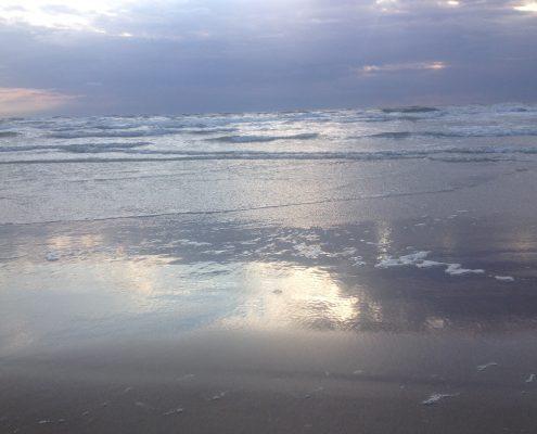 Spiegeling in de zee